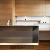 <p class='en'> 										The kitchen counter: This stainless-steel kitchen counter is custom ordered as well. This is made in a way that the joints of steel plates don't show, and the sterical shape design stands out perfectly. 									</p>