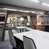 <p> 執務室からラウンジをみる: 執務室とラウンジは、ガラスと帯家具で仕切られています </p>